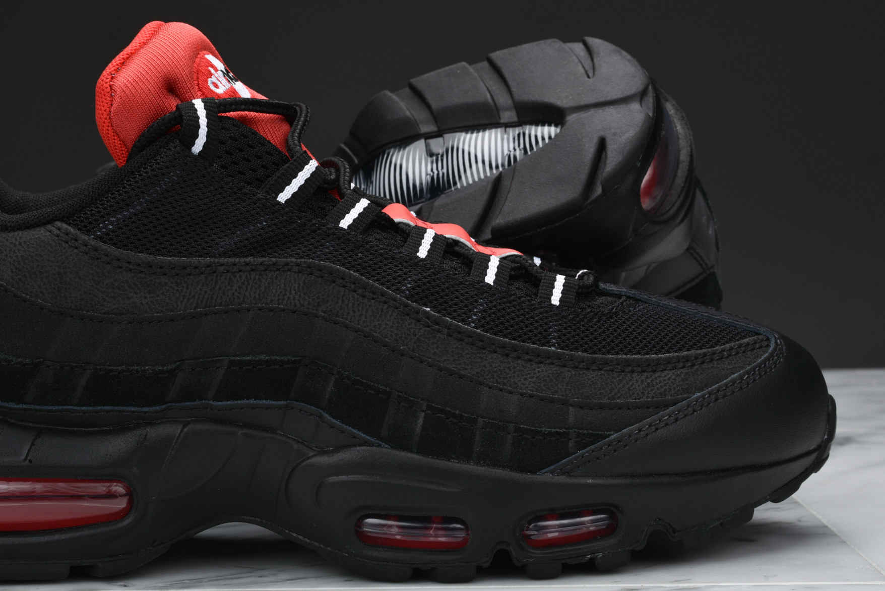 finest selection a5ab7 46f1e Pops Of Challenge Red Highlight This Nike Air Max 95 ...