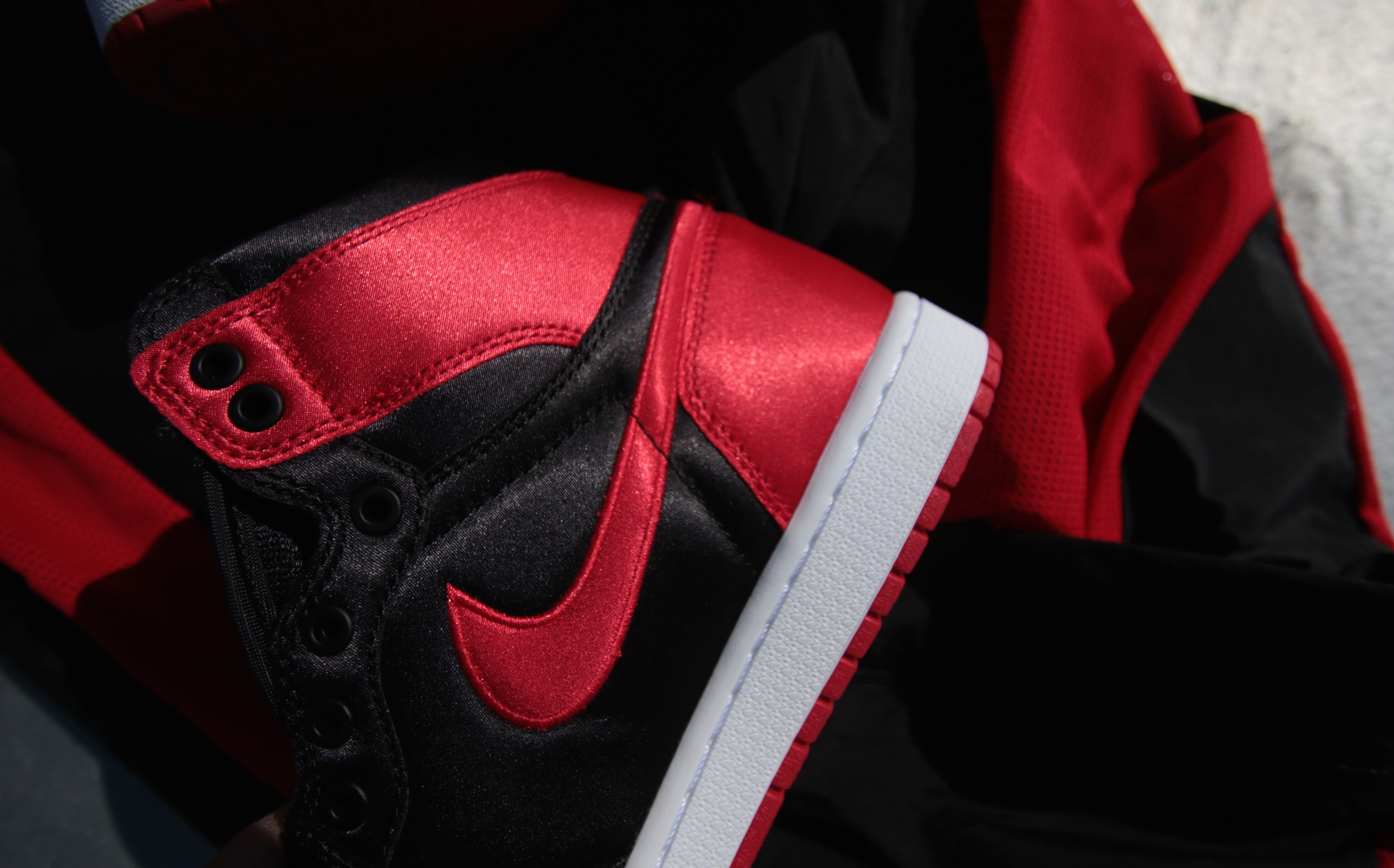 best service 6574b 2ee3b A Closer Look At The Exclusive Air Jordan 1 Banned Satin ...