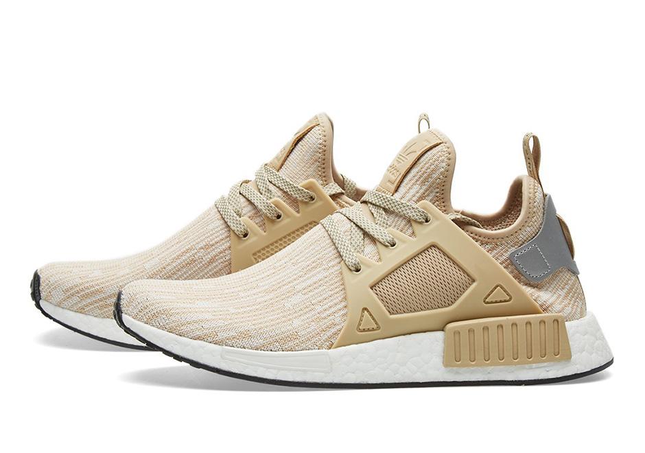 tan and white adidas