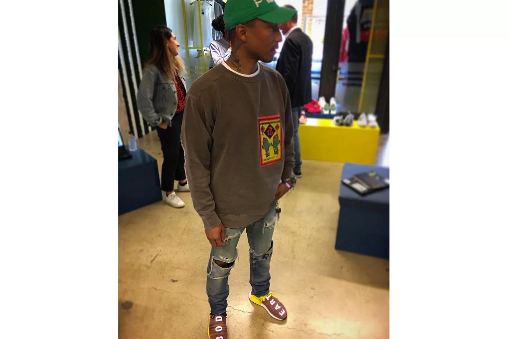 Pharrell Is Shown Wearing A New