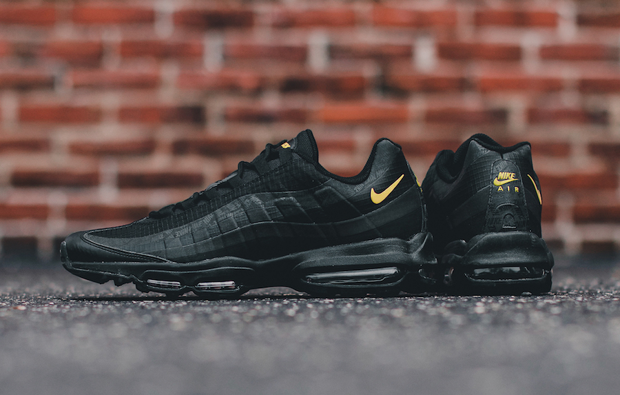 best cheap d8e72 6c11c This All-Black Nike Air Max 95 Is Hit With Pops Of Yellow ...
